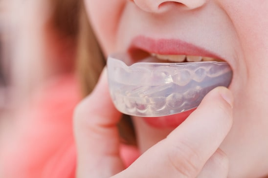 Use an anti-snoring mouth device